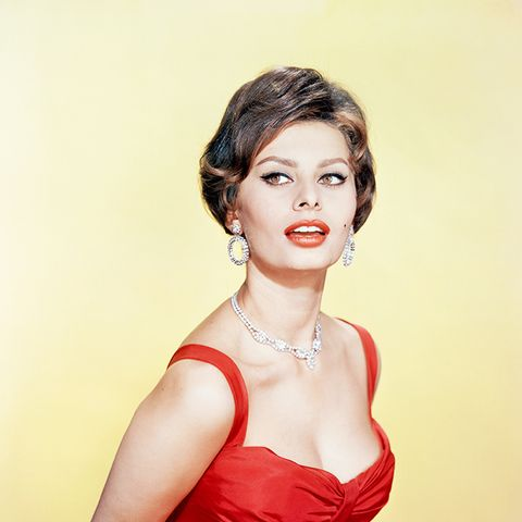sophia loren style: in a red dress, red lips, and lined eyes