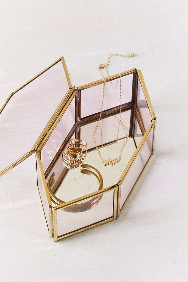 A mirrored glass box like this makes your best items feel so special. Shop Our Pick:Urban OutfittersDiamond Glass Display Box ($30)
