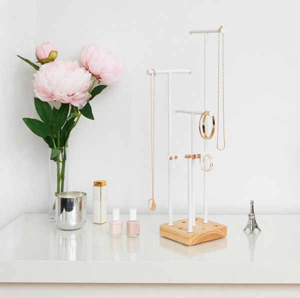 Hang hoop and drop earrings alongside your necklaces. Even put your rings on the lower tiers. Shop Our Pick: UmbraAcro Jewelry Tree ($30)