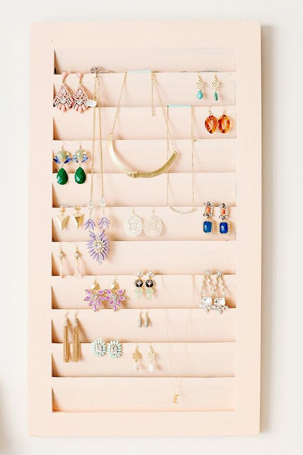 Repurposed wooden blinds make for the most creative earring storage situations.