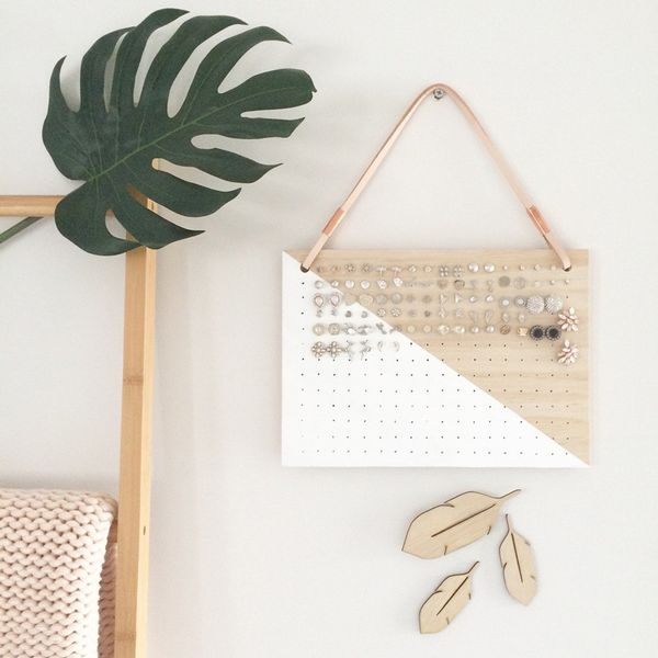 Clear up space on your dresser by hanging a cool earring holderlike this one make froma slab of wood and a leather string. Shop Our Pick:EtsyHanging Earring Holder With...