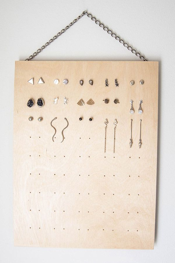 Another simple DIY earring holder takes a square piece of wood and drills in small holes just big enough for your earring posts. We love this idea because you can make as many or as few spots as...