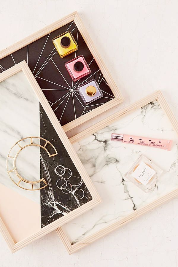 Instead of just plopping your earrings down right on your dresser, try a pretty jewelry tray like these marble and wood ones to display your jewelry and keep it relatively organized at the same...