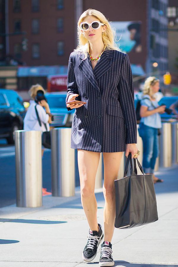 We love a good navy pinstripe but especially when the business-casual separateis given the streetwear treatment (sneakers and oversize sunglasses).