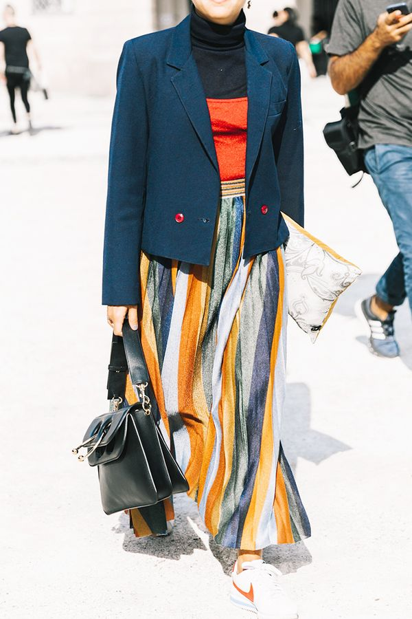 We love how this look utilizes the black turtleneck toits fullest potential. Bright colors keep the black and navy from looking anything but dull.