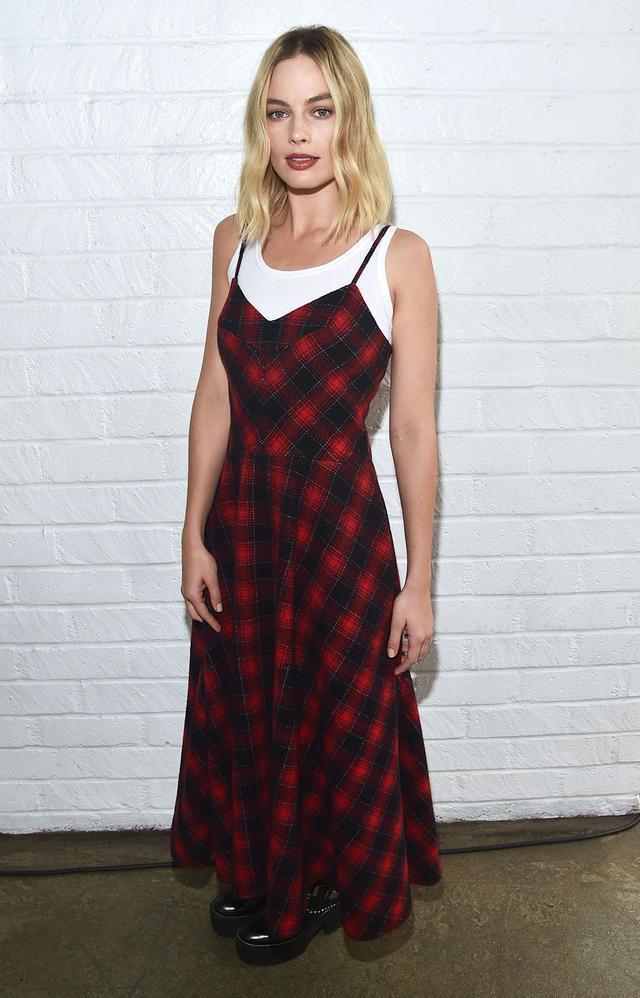 On Margot Robbie:Miu Miu dress