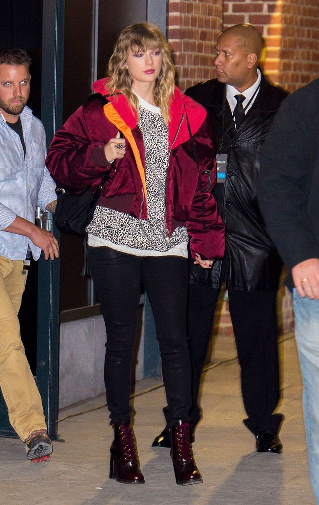 On Taylor Swift:UnravelOversized Bomber Jacket($1786); Amiri sweatshirt; Prada boots