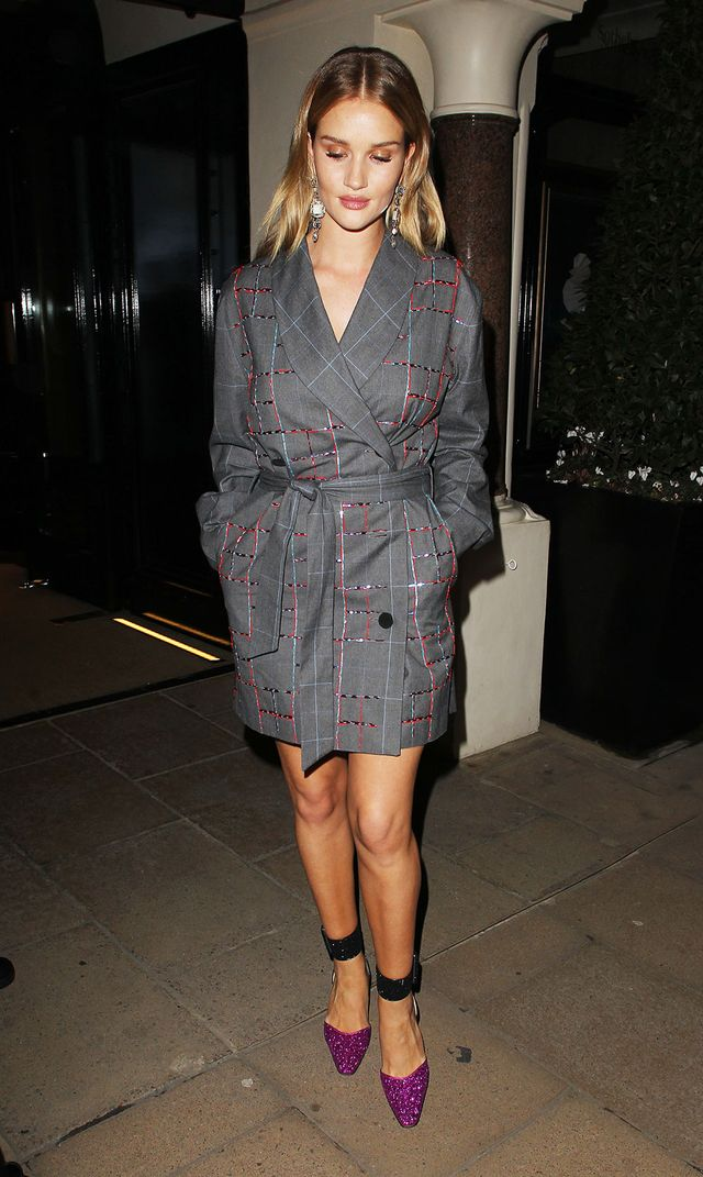 On Rosie Huntington-Whiteley: Attico Violet Double-Breasted Jacket ($2001), Suede Ankle Straps ($599), and Diletta Glitter Pumps ($815)