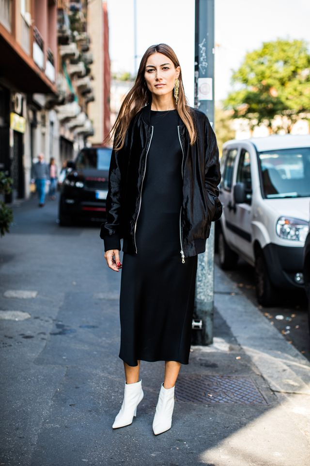 Pair a black midi dress with a bomber jacket and statement boots for an effortless, classic outfit.