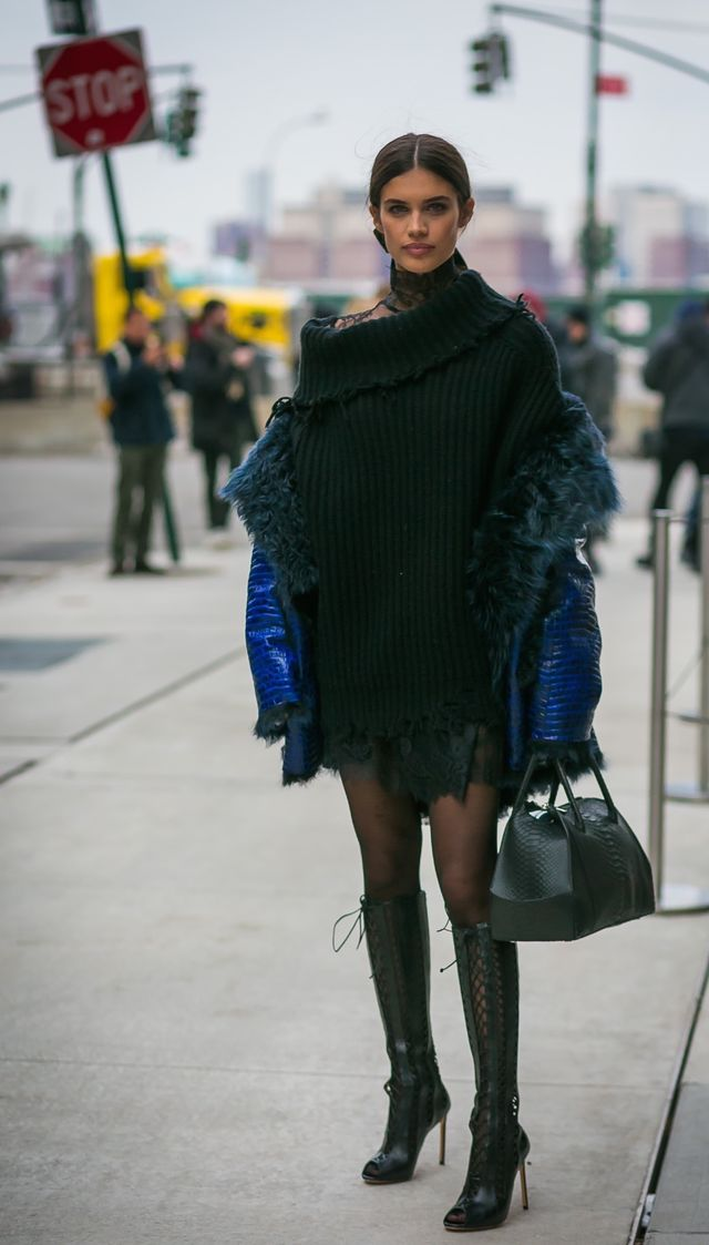Wear an oversize sweaterdress with boots and a statement coat for a sultry yet warm look.