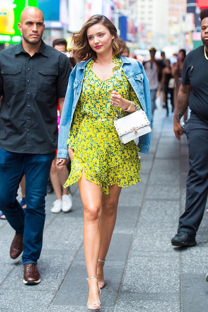 Miranda Kerr wearing green dress and denim jacket while pregnant