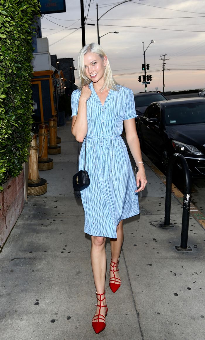 Karlie Kloss wearing blue dress and red sandals