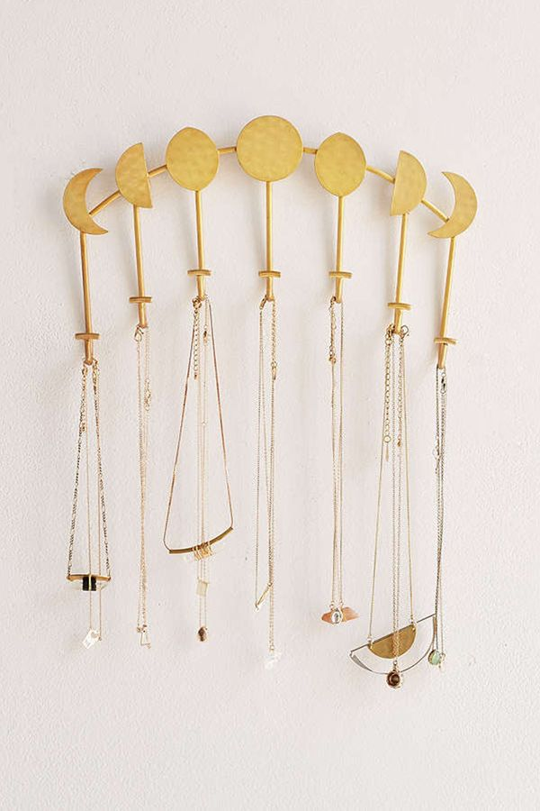 Give your room décor some celestial vibes with this phases of the moon necklace holder. Shop this necklace holder: Magical Thinking Artemis Wall Mounted Necklace Holder ($24).