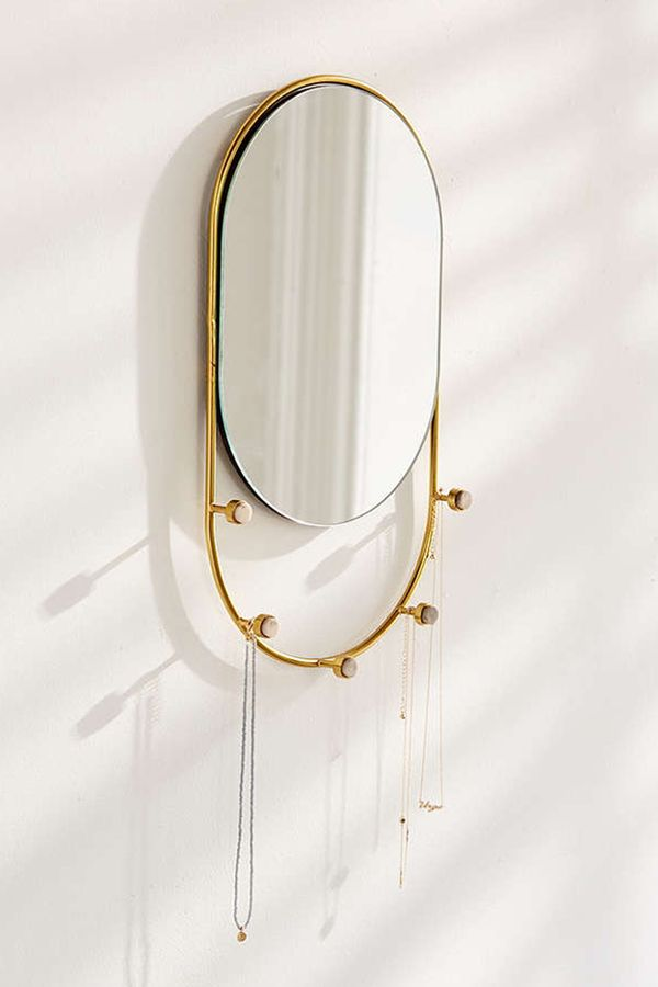 This minimally designed mirror is perfect for hanging necklaces, key,s and other small accessories. Shop this necklace holder: Pia Jewelry Storage Mirror ($39).