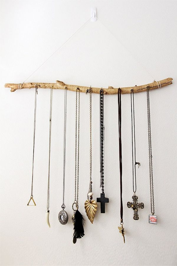 DIY your own necklace holder from a wooden branch. Doubles as a rustic-chic décor finish.