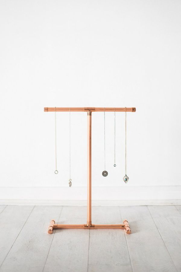 This simplistic copper pipe necklace holder is the perfect size to sit on your dresser or shelf. Shop this necklace holder: Little Deer Copper Pipe Jewelry Stand for Necklaces ($37).