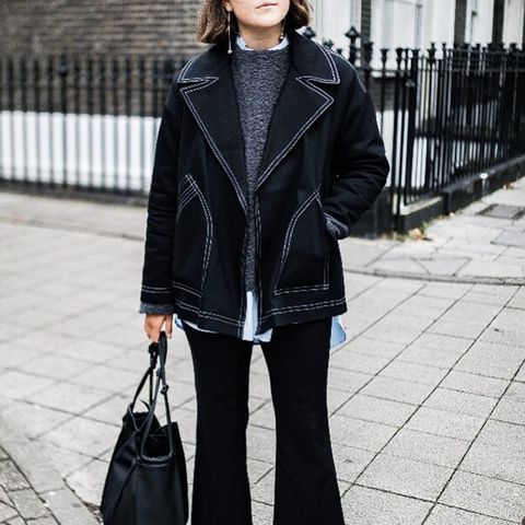 what to wear in December: Charlie May wearing an all-black outfit with light shoes