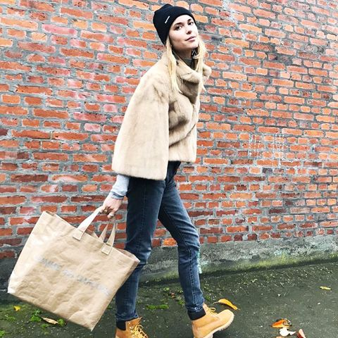 what to wear in December: Pernille Teisbaek wearing Caterpillar boots, jeans and a beanie