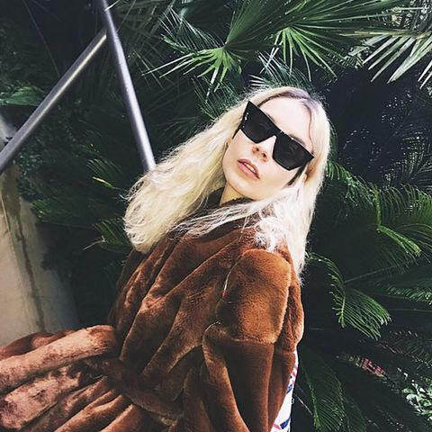 what to wear in December: Irina Lakicevic in a faux fur coat
