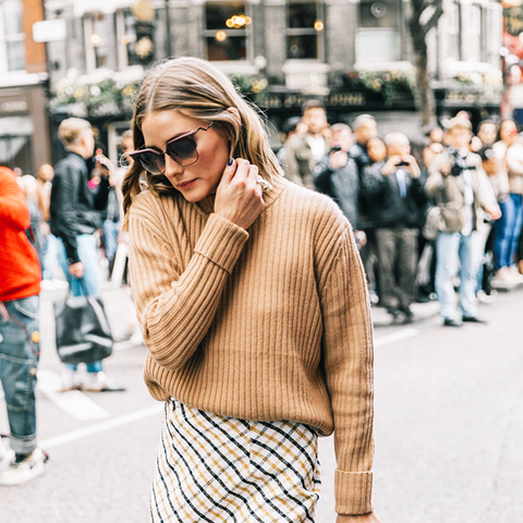 how to wear a pencil skirt: olivia palermo tucked in a cosy sweater to her skirt