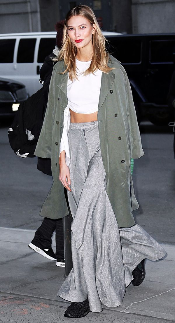 Karlie Kloss Wears Crop Top, Trousers, and Running Shoes