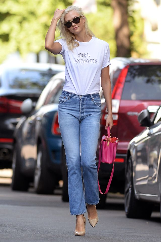 On Karlie Kloss: Re/Done High Rise Jeans ($305); Jimmy Choo Anouk Patent Leather Pumps ($595); Louis Vuitton bag