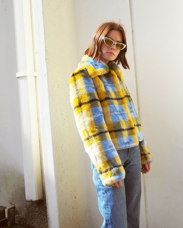 """Go full-tilt retro in a statement-making coat, cat-eye sunnies, and mom jeans. Your friends might call you """"extra"""" for wearing sunglasses out at night, but we stand by our opinion that..."""