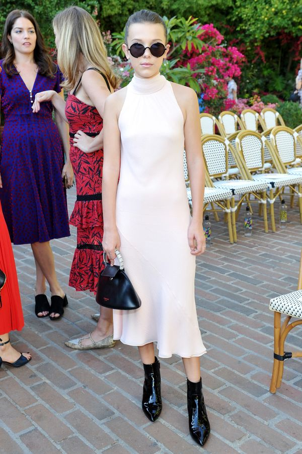On Millie Bobby Brown: Calvin Klein dress and shoes; Gentle Monster sunglasses