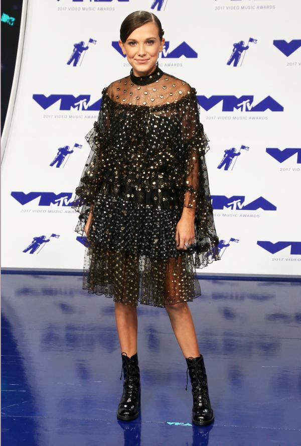 On Millie Bobby Brown: Rodarte dress; Stuart WeitzmanClimbing Boots ($351)