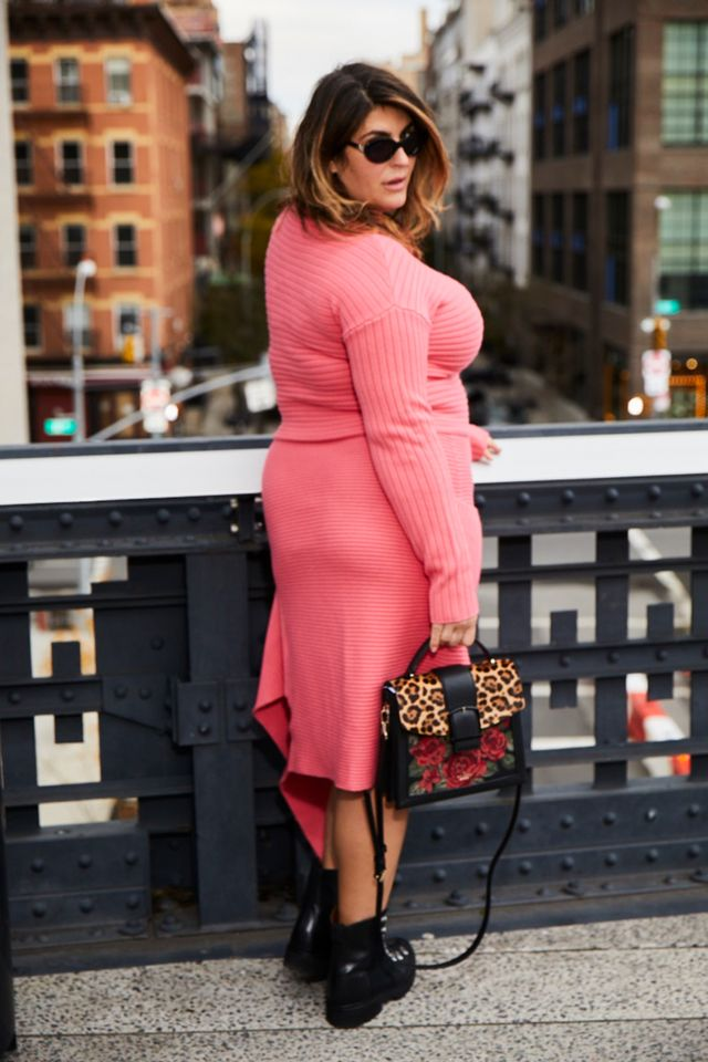 A pink sweater and asymmetrical skirt are the perfect foil to a pair of grungy combat boots. Pro tip: Stretchy knits are often forgiving and enable you to size down, so try it on before assuming...