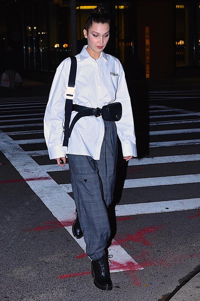 On Bella Hadid:Julia Seemann Incubus Succubus Shirt($314);Dr. Martens Persephone Boots($160); Parisa Wang bag belt