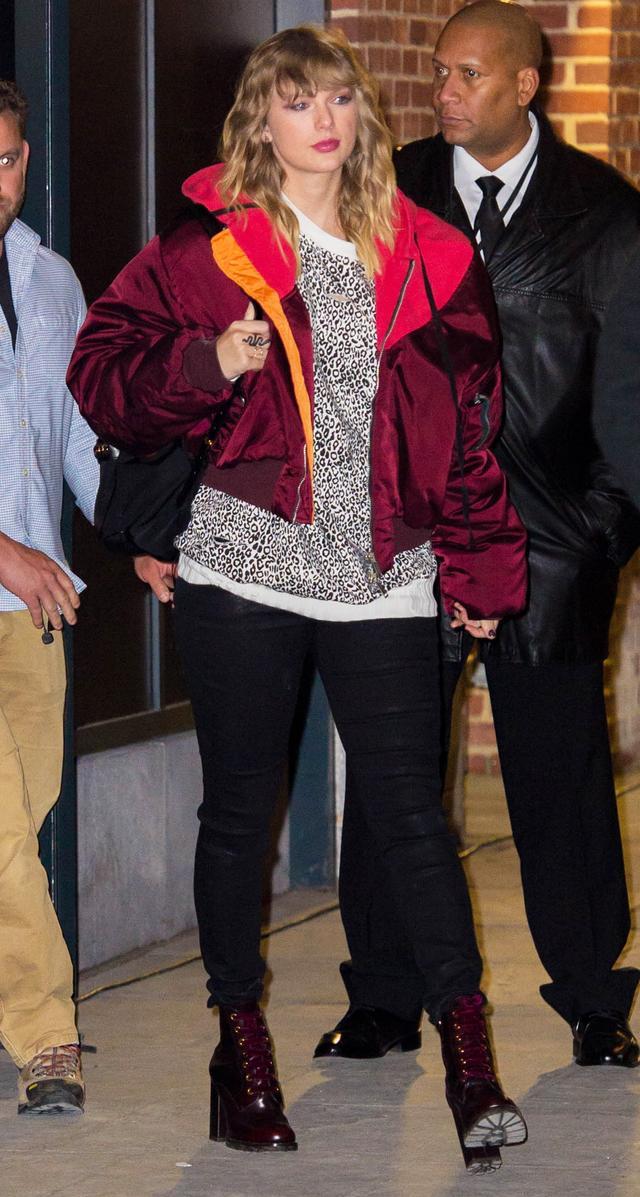 On Taylor Swift:AmiriLeopard Sweatshirt($665);Unravel ProjectOversized Bomber Jacket($1251);Prada lace-up booties