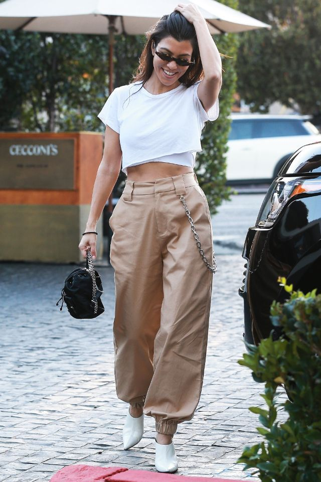 On Kourtney Kardashian: I.Am.Gia Cobain Pants ($84); Céline mules; Prada backpack