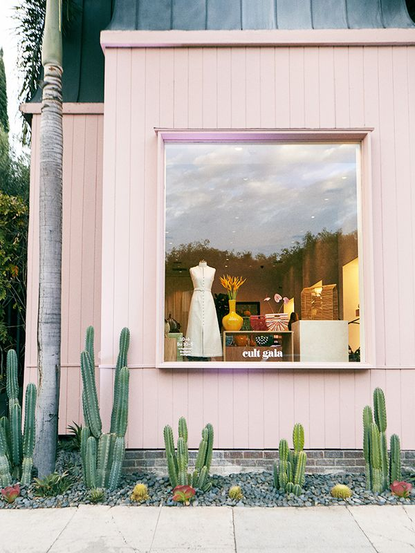 The light pink shop pops behind succulents in L.A.'s iconic retail destination Melrose Place.