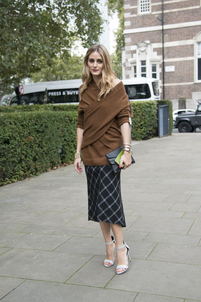 Olivia Palermo wears an off-the-shoulder sweater.