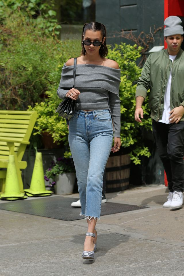 Bella Hadid wears an off-the-shoulder sweater.