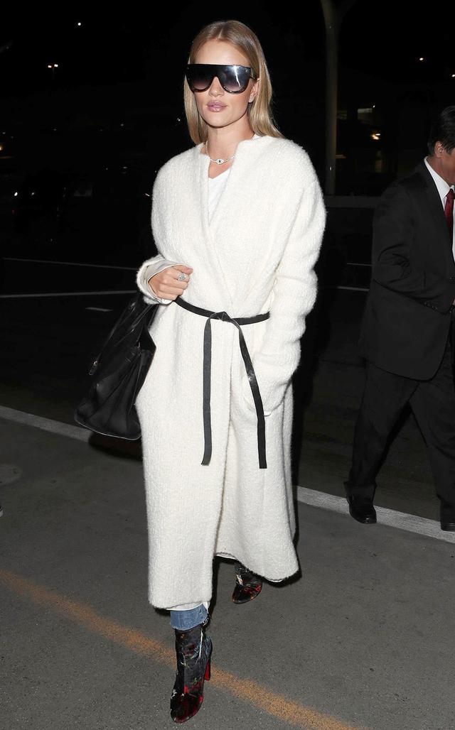 On Rosie Huntington-Whiteley: Isabel Marant coat; Céline sunglasses; Saint LaurentSac de Jour Tote ($3490); Christian LouboutinMoulamax Boots ($945, available in petrol) Similar...