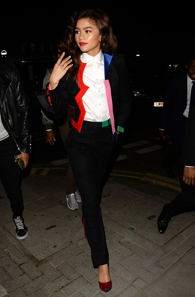 On Zendaya:Ronald van der Kemp suit; Casadei shoes Similar Styles:ZaraCrossed Blazer($90) andTrousers With a Vertical Ruffle($50); PradaLeather...