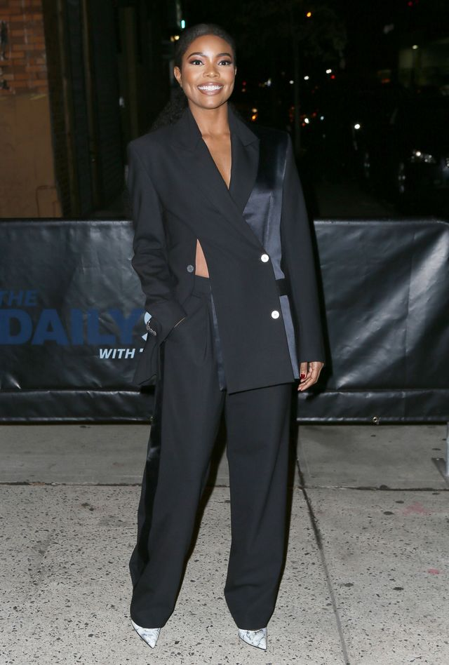 On Gabrielle Union: Dion Lee blazer and pants (unavailable) Similar Styles: Zara Crossed Blazer ($90) and Palazzo Trousers ($50); Aquatalia Michaela Point Toe Pumps ($395)