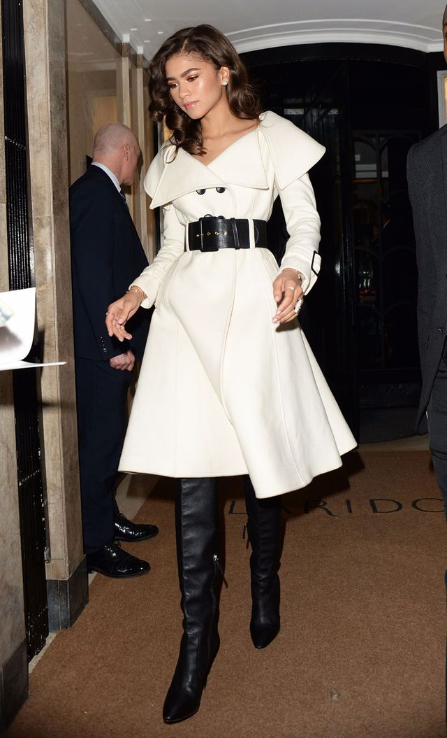 On Zendaya: Giuseppe di Morabito coat; Giuseppe Zanotti boots Similar Styles: Edeline Lee Belted Midi Coat ($695); ASOS Klara Over the Knee Boots ($111)