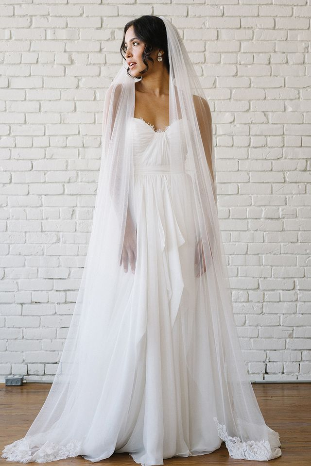 The wedding veil styles thatll be trending in 2018 whowhatwear uk exquisite lace is artfully placed and meticulously stitched into an elegant design that sweeps softly behind junglespirit Image collections
