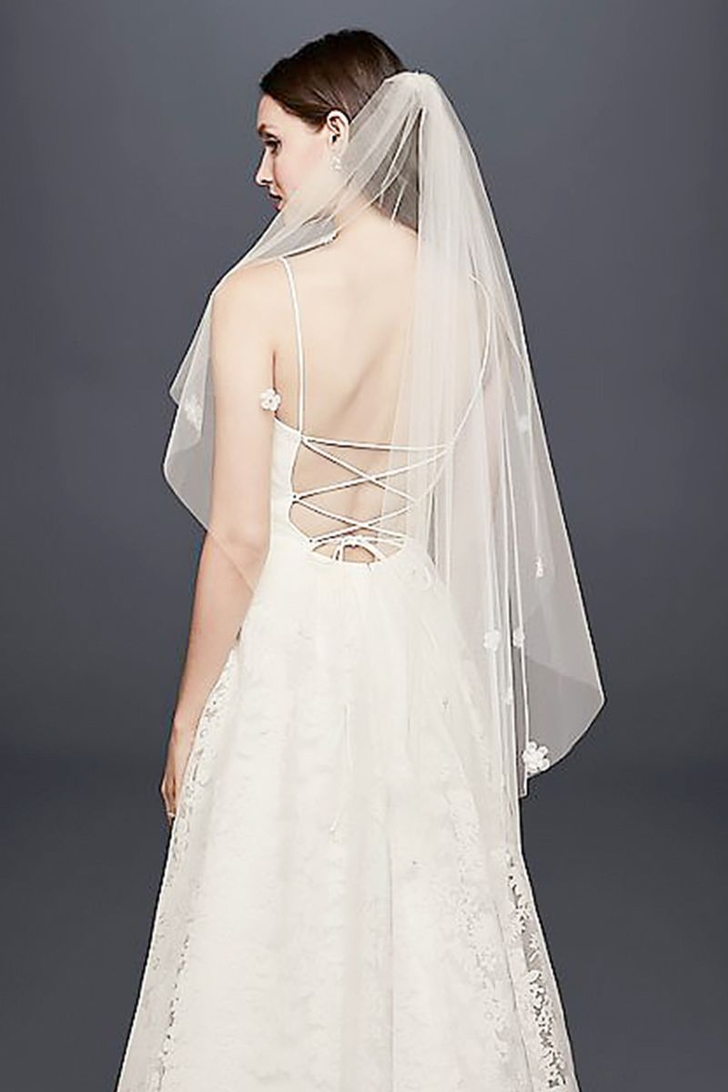 The wedding veil styles thatll be trending in 2018 fashion jerseys three dimensional floral appliqu accents give this chapel length veil a playful feel shop the style davids bridal 3d floral elbow length veil 140 junglespirit Choice Image