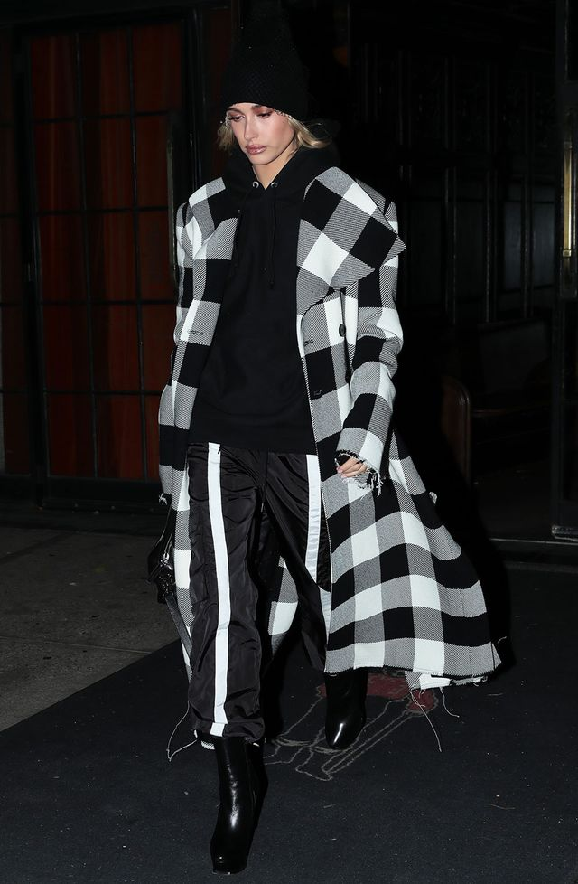 On Hailey Baldwin: Marques'Almeida Checked Coat ($978); Danielle Guizio Guizio Nylon Trackpants ($140); YSL boots Similar Styles: Madeleine Thompson Holby Cashmere Beanie...