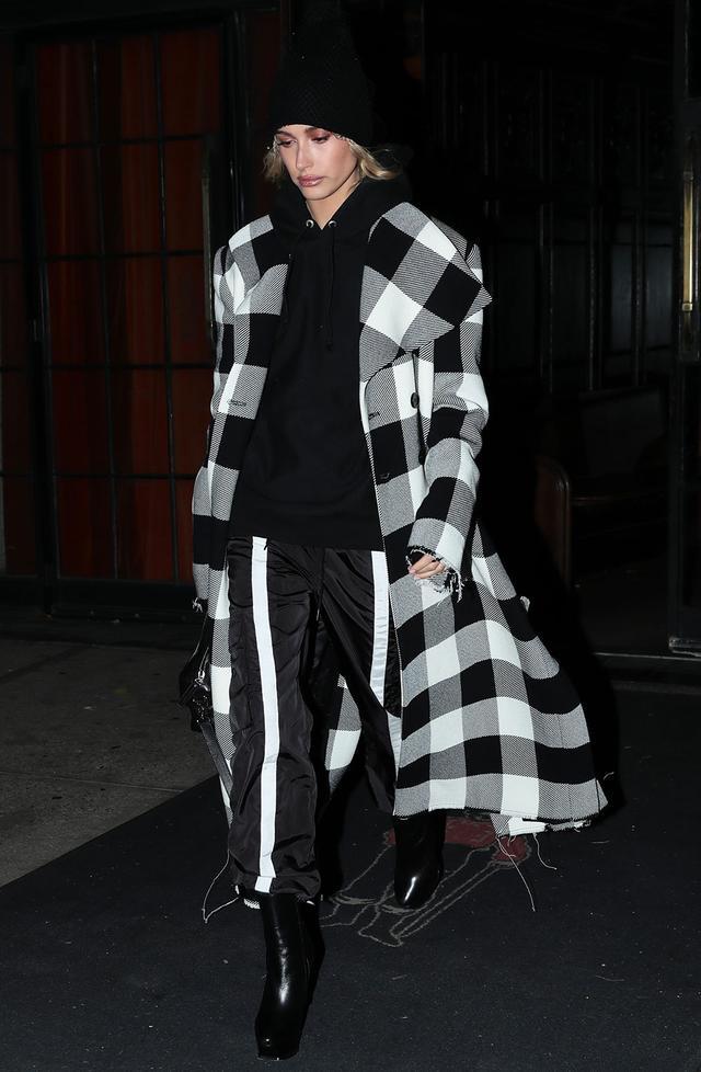 On Hailey Baldwin: Marques'AlmeidaChecked Coat ($978); Danielle GuizioGuizio Nylon Trackpants ($140); YSL boots Similar Styles:Madeleine ThompsonHolby Cashmere Beanie...