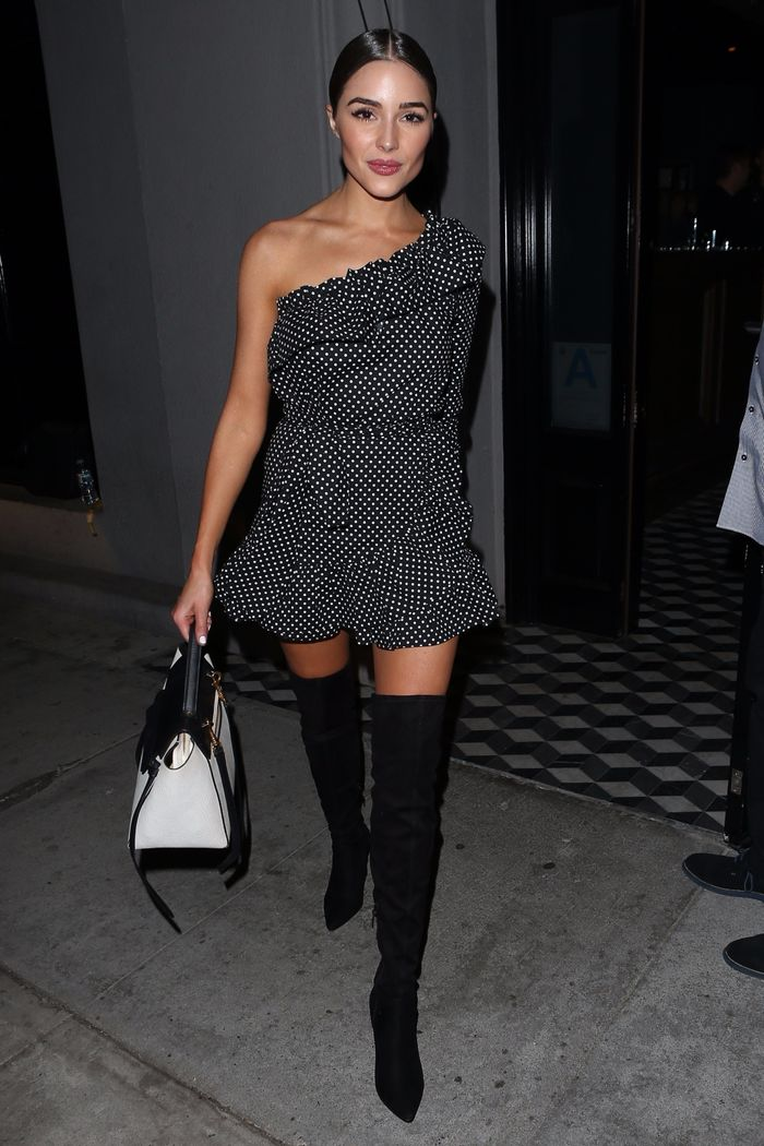 Olivia Culpo wearing over the knee boots