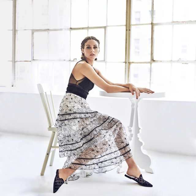 On Olivia Palermo: Pretty Ballerinas Ella Black Polka Dot Mules ($179) Available in sizes 35 to 42.