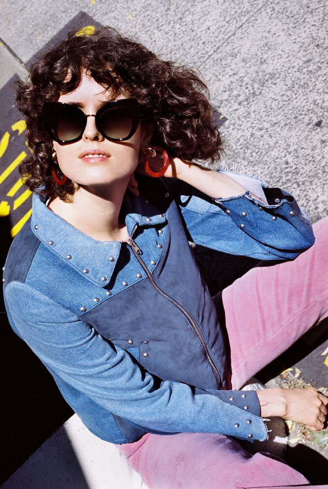 Fashion credits: Chloe wears Dolce & Gabbana DG4319sunglasses, $380 fromSunglass Hut. M.I.H Jeans jacket, $740. Rollas pants, Coming soon. Valet Studio earrings, $129.