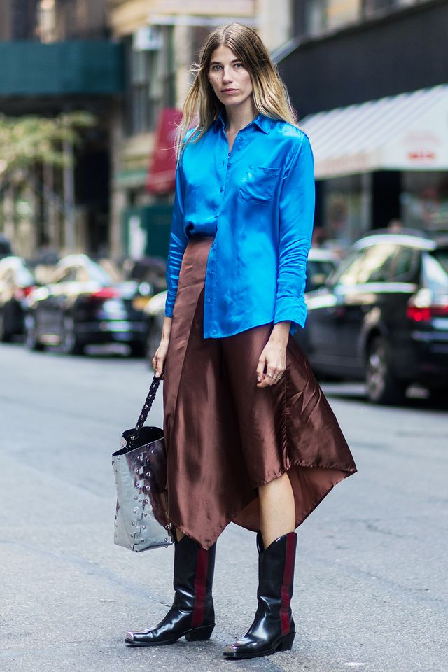 Balance traditional cowboy boots with a romantic ensemble—like this color-blocked silk combo, for example.