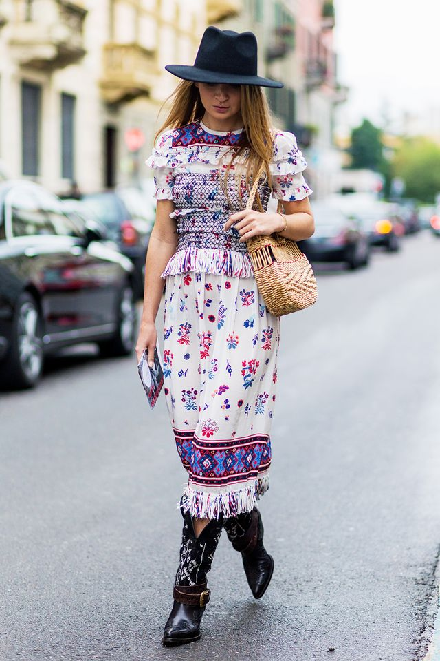 Dresses boasting frills, florals, paisley, and fringe deliver a playful take on Western sensibilities, especially when paired with a Stetson hat and detailed cowboy boots.
