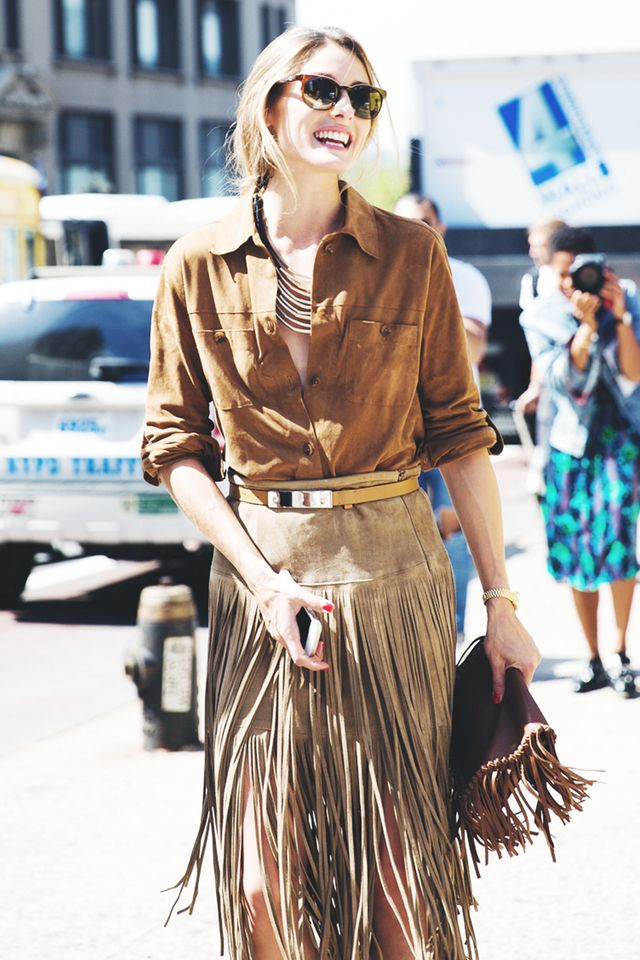 Instantly infuse your outfit with major Western vibes by incorporating details like tan suede, natural leather belts worn at the waist, and plenty of fringe.